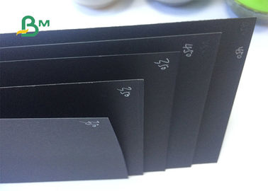 China 100% Virgin Pulp Surface Glossy Recyclable Black Paper For Hardcover supplier